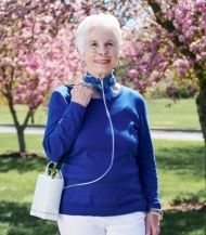 The Inogen G4 portable oxygen concentrator  woman user outdoors.